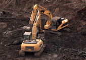 Two excavators on the construction of the new facility. — Stock Photo