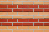 Wall of yellow-red brick. — Stock Photo