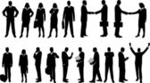 Collection of business people in silhouette in different poses — Stock Vector