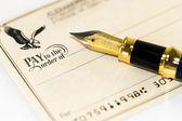 Writing a check — Stock Photo
