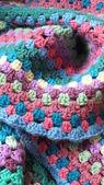 Handmade crocheted blanket — Stock Photo