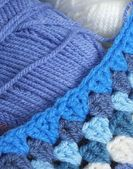 Blue wool and crochet — Stock Photo