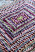 Vintage colored crochet afghan — Stock Photo