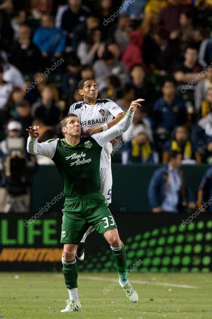 CARSON, CA. - April 23. Los Angeles Galaxy defender Sean Franklin N5 gets over Portland Timbers forward Kenny Cooper N33 in anticipation of header during the Major L — Stok fotoğraf #14180164