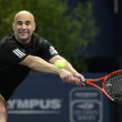 Andre Agassi and John McEnroe play a charity match — Foto Stock