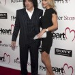 Musician Paul Stanley and Erin Sutton arrive at The Heart Foundation Gala at Hollywood Palladium - Stock Photo