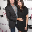 Muscian Tommy Thayer and Amber Thayer arrive at the Heart Foundation Gala at the Hollywood Palladium — Stock Photo