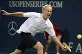 Andre Agassi and John McEnroe play a charity match — Stock Photo
