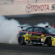 Tanne Foust competes at Toyota Speedway during Formula Drift - Stock Photo