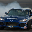 Justin Pawlak competes at Toyota Speedway during Formula Drift - Stock Photo