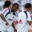 Shavar Thomas (L) &amp;amp; Mariano Trujillo (R) on football pitch - Stock Photo