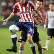 Sam Cronin and Sacha Kljestan fight for the ball during the match - Stockfoto