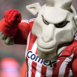 Chivas mascot getting the fans involved during half time of the match - Stock Photo