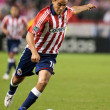 Jesus Padilla dribbling the ball up field during the match — Stock Photo #14588879