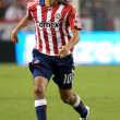 Jesus Padilla dribbling the ball up field during the match — Stock Photo #14588881