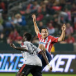 Emmanuel Gomez and Bojan Stepanovic fight for the ball during the match - Stock Photo