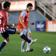 Ganzalo Pineda and Marcelo Saragosa in action at the match - Stock Photo