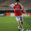 Gonzalo Pineda passing the ball during the match — Stock Photo #14589225