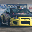 Постер, плакат: Tanner Foust competes at Toyota Speedway during Formula Drift round