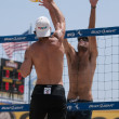 Phil Dalhausser and Todd Rogers vs. John Hyden and Sean Scott playing volleyball - Stock Photo