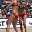 Stock Photo: Jen Kessy and April Ross vs. Nicole Branagh and Elaine Youngs playing volleyball