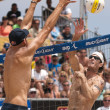 Phil Dalhausser and Todd Rogers vs. John Hyden and Sean Scott take part in volleyball match — ストック写真