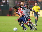 Jonathan Bornstein dribbles away from O'Brian White and Jesse Marsch during the match — Stock Photo