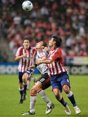 Ante Jazic and Pablo Vitti fight for the ball with Sacha Kljestan in the background during the match — Stock Photo