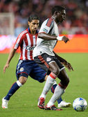 Mario Trujillo defending against Emmanuel Gomez during the match — ストック写真
