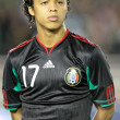 Постер, плакат: Giovani Dos Santos before the start of the game