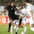 Giovani Dos Santos gets mugged by the New Zealand defense during the second half of the match - 图库照片