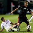 Giovani Dos Santos holds off Tony Lochhead to maintain possession of the ball during the match — Foto de Stock