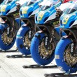 Постер, плакат: Team Rockstar Makita Suzuki has 4 bikes lined up before the start of the race