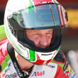 Постер, плакат: Larry Pegram on a Ducati 1098R right before the start of the race