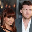 Sam Worthington and girlfriend Natalie Mark attend the Clash of the Titans premiere - Stock Photo