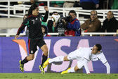 Braulio Luna wins possession of the ball after Leo Bertos looses his balance during the match — Stock Photo
