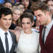 Taylor Lautner Kristen Stewart and Robert Pattinson attend Twilight SagEclipse Los Angeles premiere — Stock Photo #14899851