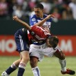Daniel Hernandez and Chivas Justin Braun fight for the ball during the game — Stock Photo
