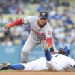 Scott Podsednik tries to beat the tag by Alberto Gonzalez during the match — Stock Photo