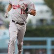 Постер, плакат: Ryan Zimmerman rounds second after smashing a two run homer during the game