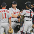 Some of the Nationals infield have a quick meeting while waiting for a relief pitcher to take the mound during the game — Stock Photo