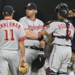 Some of the Nationals infield have a quick meeting while waiting for a relief pitcher to take the mound during the game — Stock Photo #14901207