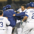 James Loney gets rushed by teammates after batting in the winning run of the game - Stock Photo