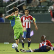 Stock Photo: Michael Lahoud tries to poke ball away from Alvaro Fernandez during game