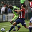 Blaise Nkufo and Michael Umana fight for the ball during the game - ストック写真