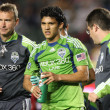 Fredy Montero walks off a mid air collision during the game — Foto de Stock