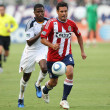 Edson Buddle chases down Chivas USA defender Ante Jazic during the game — Stock Photo
