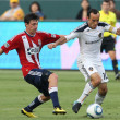 Ben Zemanski and Landon Donovan in action during the — Stock Photo