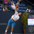 Jack Sock practices his serve against Flavio Cipolla during the tennis match - Stock Photo