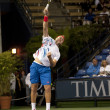 Jack Sock smashes a return to Flavio Cipolla during the game - Stock Photo